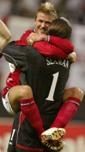 Beckham leaps into his goal keeper's arms in 2002 (David Seaman).