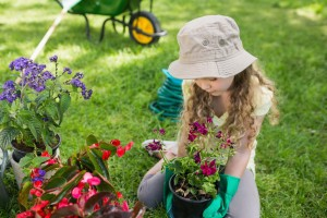 Full length of a little young girl engaged in gardening