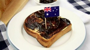 stock-footage-australian-flag-being-put-in-a-piece-of-toast-with-butter-and-vegemite