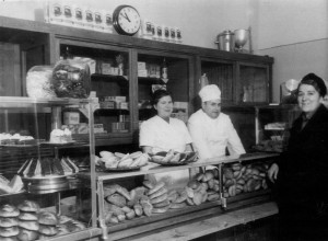 "My Opa, his second wife, and a customer my mom called, ""Just Some Lady"" in his bakery. Frankfurt am Mein, c. 1930s."